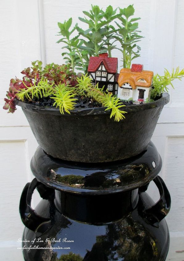 Here's another! Clearance concrete pot for $1, two little houses from a yard sale for $1 and plants from the yard!