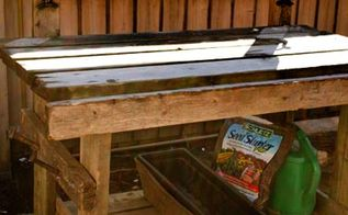 potting tables from random bits, gardening, painted furniture, repurposing upcycling, Old deck boards two ceiling fan blade holders 2 rail spikes and some paint