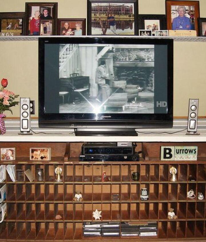 Old letter sorter turned entertainment center / what not shelf.