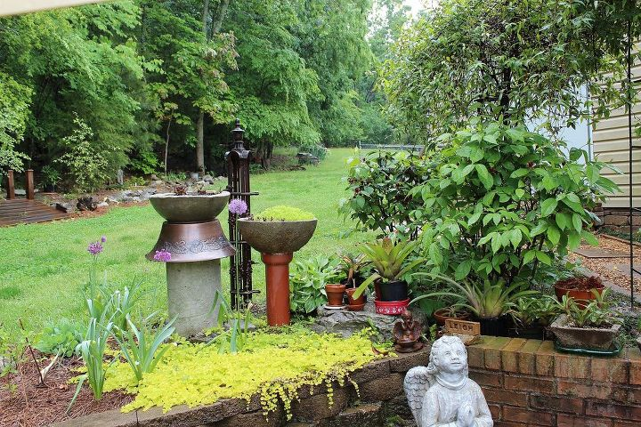 I love yard art. I discovered hypertufa several years ago and have been creating my own pots and columns ever since. I visit antique shops and junk shops often for items I can turn into more yard art.
