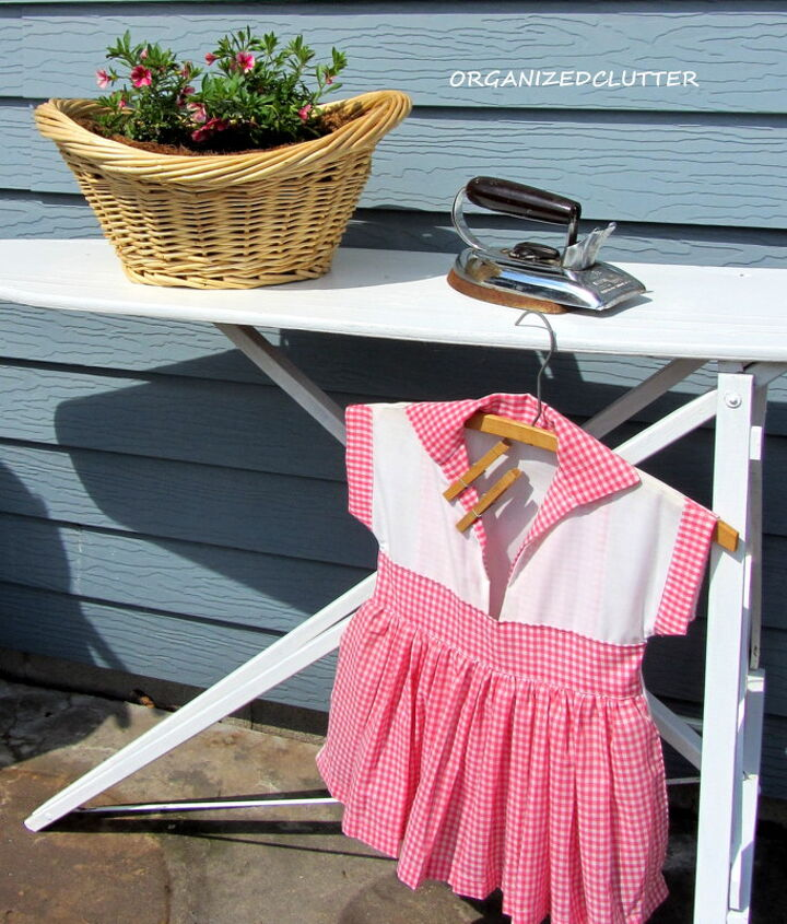An old ironing board that I recently painted white makes a great out door vignette on the patio.