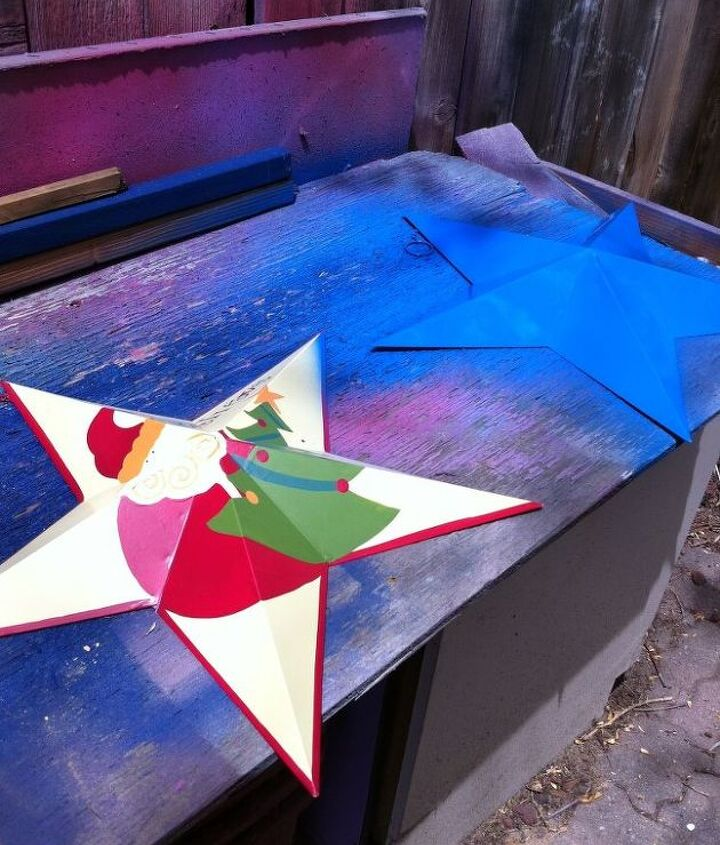 I started with two stars I've had forever but no longer use. They had Christmas scenes on them so I got some blue spray paint and covered that up.