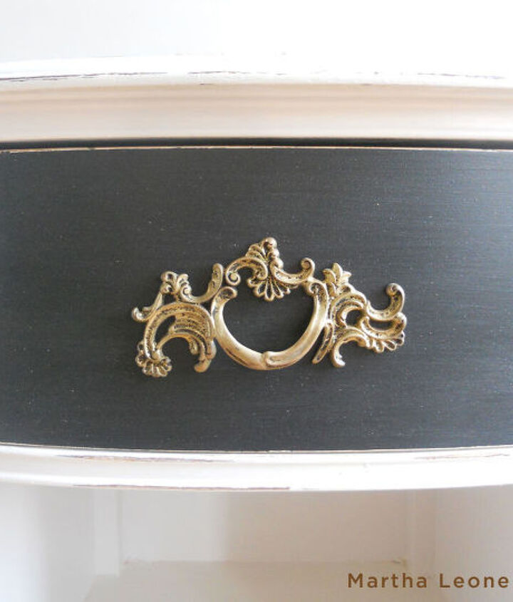 The beautiful original drawer pulls were spray painted gold but I didn't cover them completely with the new color so that they looked antiqued.
