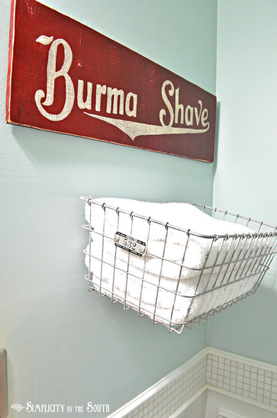 storage for towels with a wire basket and a hand painted sign that I made
