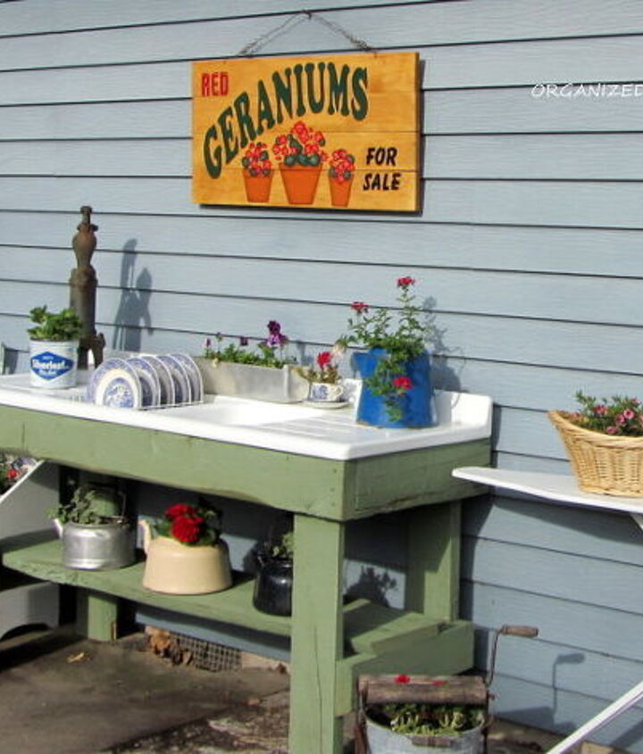 """The rest of the """"outdoor kitchen"""", an old scrub pail and ironing board."""