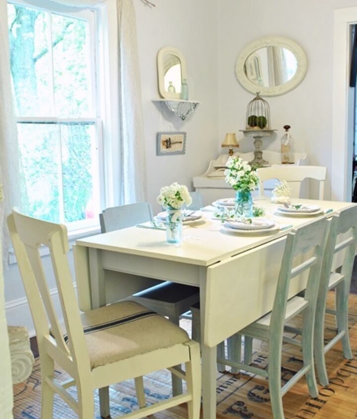 Use varying shades of white.Steam White paint by Laura Ashley has a gray-blue undertone and is used on the walls in the dining room. Paris Gray chairs and a blue mason jar with flowers add a pop of color for added interest.