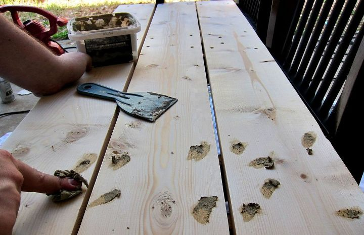 He used wood filler to cover the screws.