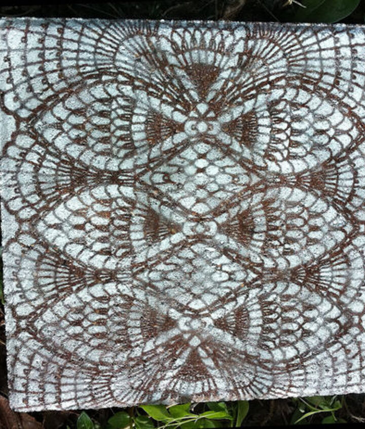 how to make lace like stepping stones, crafts, gardening, outdoor living, Allow the paint to dry remove the doily and then spray with sealer