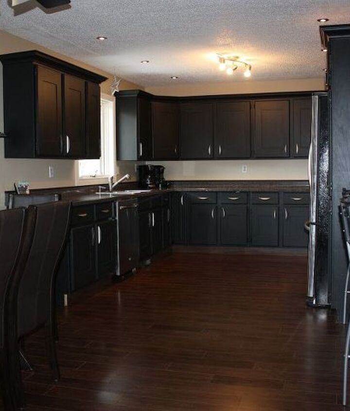 """We removed the header, added some crown molding. Put 1/4"""" mdf over the cabinet doors to hide the scalloped edges. Installed pot lights. Updated the hardware."""
