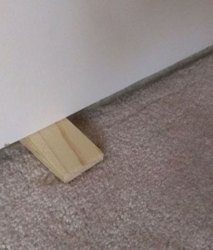 If needed, use shims to properly align the door with the jamb.