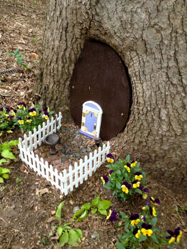 This is the finished product. We added the fence and plants to the Fairy House front yard.
