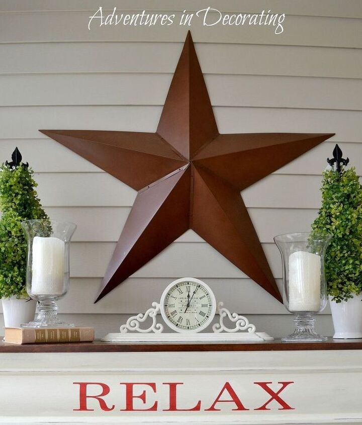 An oversized metal barn star takes center stage to simple topiaries (from Tuesday Morning).