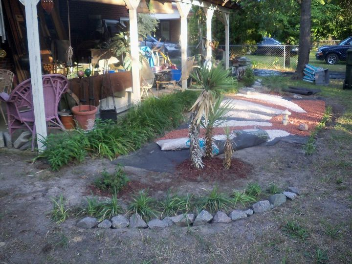 excavated area off of patio, laid useless weed block, and put pebbles stones down using two colors