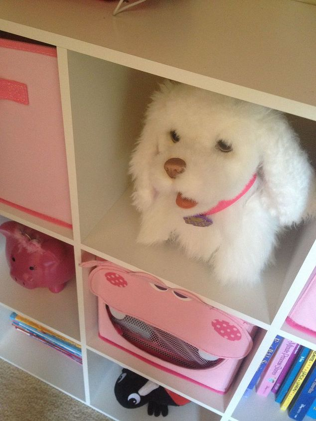 My daughter is able to easily access her toys with this open shelving system.