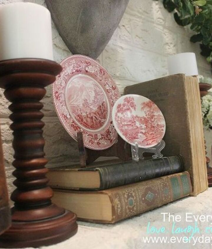 Old books and wood candlesticks lend a vintage feel.