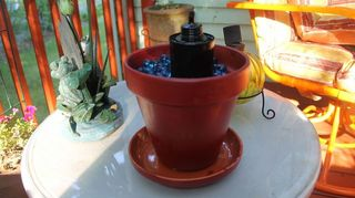 beautify your outdoor area with sterno can fire pots, crafts, outdoor living, The canister was deeper in the pot Just to show what was used to hold the oil