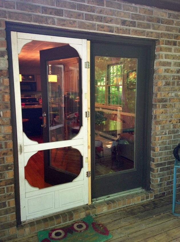 Screen door before painting and stenciling.