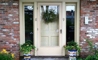 hometour to grandmother s house we go, bathroom ideas, bedroom ideas, home decor, living room ideas, repurposing upcycling, Front entryway done beautifully with Sicilian pottery seasonal wreath and antique knocker