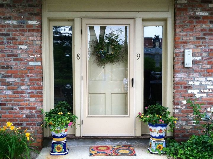 Front entryway done beautifully with Sicilian pottery, seasonal wreath and antique knocker.