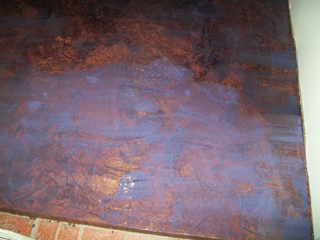 After your floor has been covered completely with paper bag pieces, dry overnight.  Then, begin applying polyurethane.  I added some RIT dye to my polyurethane to create a darker brown floor