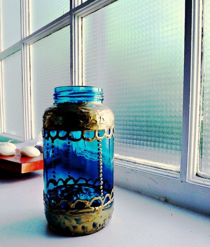 a moroccan style painted jar using spaghetti sauce jars.