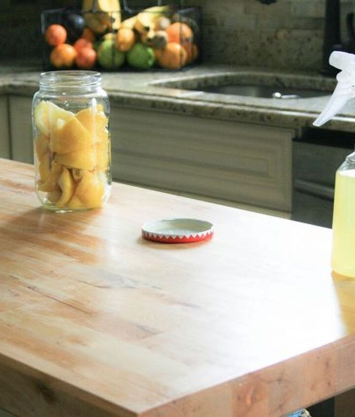 5. After lightly scrubbing the butcher block with warm warmer and a little bit of soap, liberally spray over the butcher block to disinfect and then wipe off