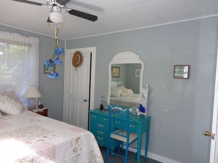 my vintage beach inspired and very thrifted guestroom is done, bedroom ideas, home decor, This is a desk I found at goodwill I mixed up my own chalk paint color and added drawer pulls The mirror I found yesterday and painted it to match the headboard Oh Hydranges drying now