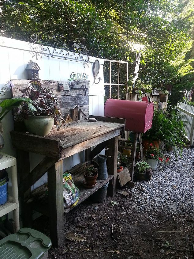 From the back looking out. I love my potting bench I made 3 years ago from barn wood from a trip to Kentucky and scraps from the deck project.