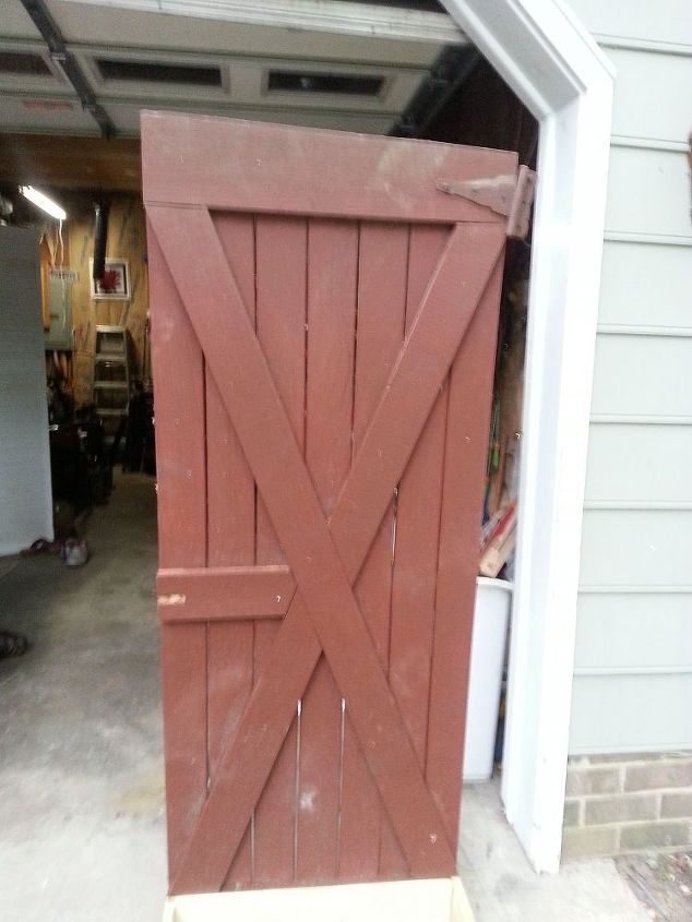 the shed door her hubby threw out.He did not really seem to enthused about her having a potting bench.