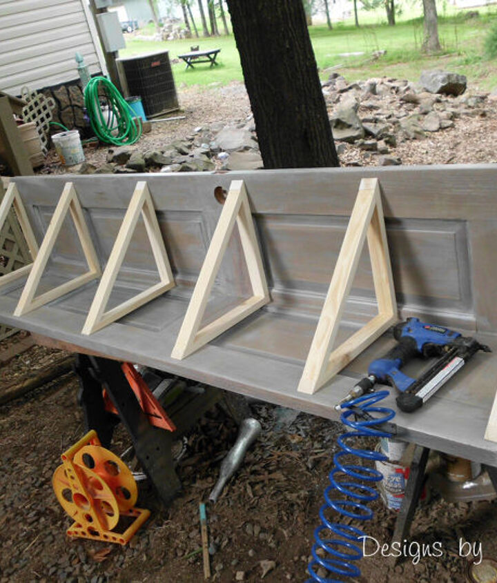 build a corner bookcase using a door, diy, how to, repurposing upcycling, woodworking projects, The completed frames before the shelves were installed