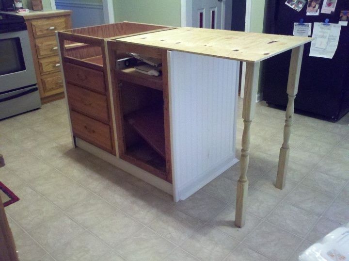 Getting an idea of how the legs will look, and how far to have the top extend from the cabinets.