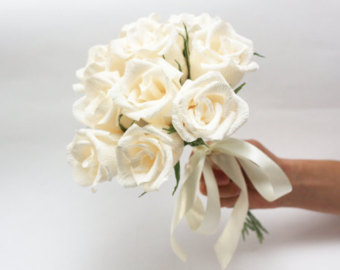 Tired of expensive white rose wedding bouquets? Make one on your own with crafting paper!  You'll be amazed how easy it is to crate one of these!