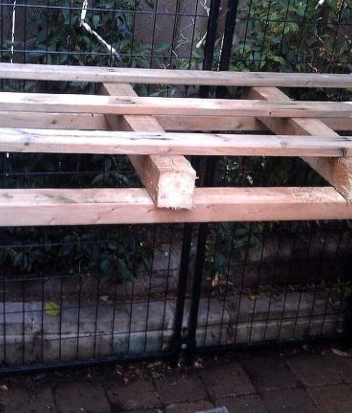 """I started by cutting a 6x4 pallet in half lengthwise to make an """"L"""" shaped table base. The gate panels in the back were used to keep my dogs from going behind my aviary. This area was such an eyesore!"""