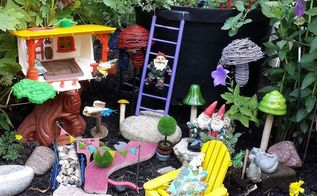 garden walk fairies gnomes and flower garden design, flowers, gardening, outdoor living, repurposing upcycling, The Gnome Garden made with toys is a delightful surprise as you walk along the flower beds