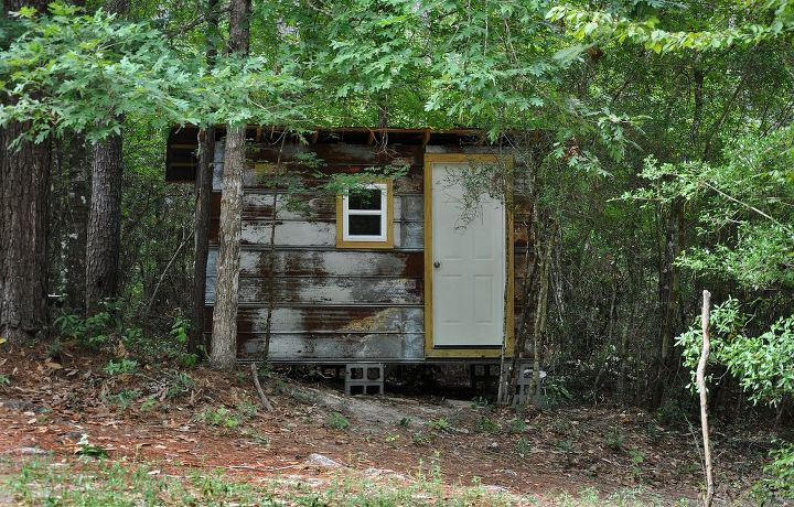Rustic exterior leads to a bit more comfort inside. . . .