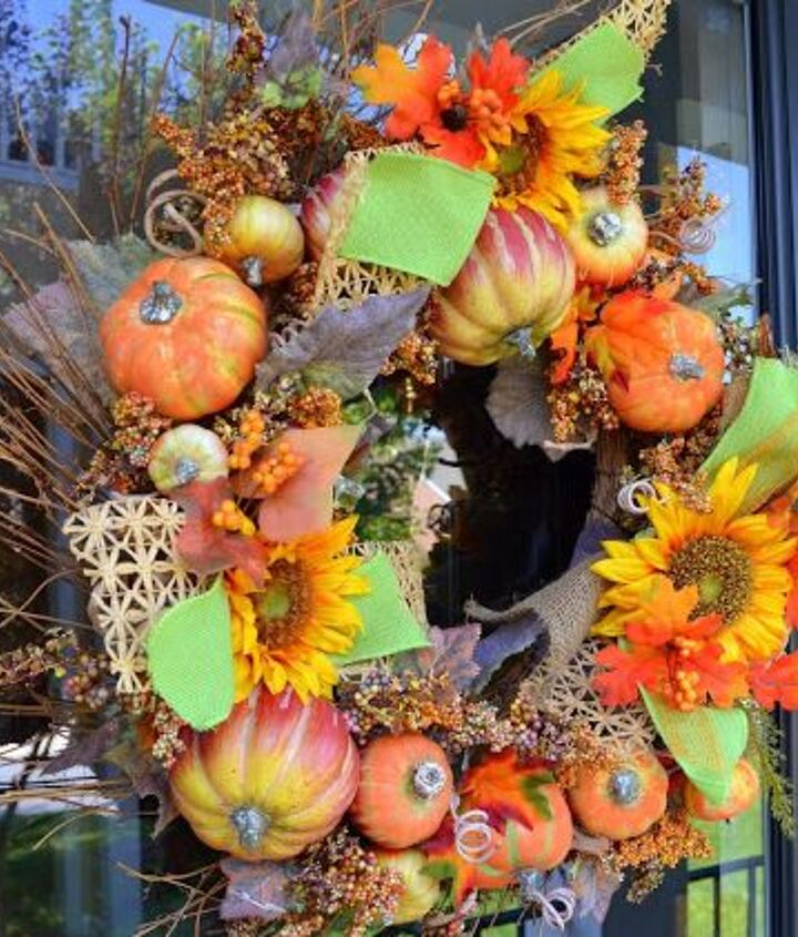 Pumpkin wreath beefed up with bits of raffia and green burlap ribbon