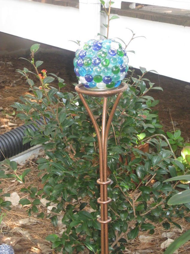 small glass globe place on a metal garden stake that I painted copper.