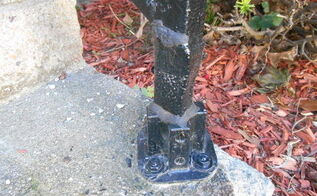 rusted loose black iron railing, curb appeal, diy, home maintenance repairs, painting, stairs, He remove the rusted area of the lower post slip a pie preesure threated up inside wrappedv a piece of aluminum sheet metal around it sealed with a silicone glue and spray piant