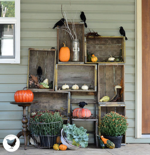 piles of beautiful junk for 2013 fall, outdoor living, repurposing upcycling, seasonal holiday decor, Pepsi crates piled high filled with Fall goodies
