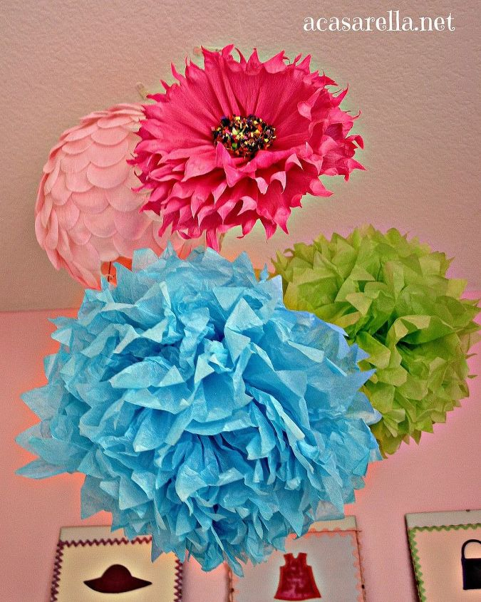 A cluster of lanterns and pom poms is an inexpensive way to add color and fun to the space.