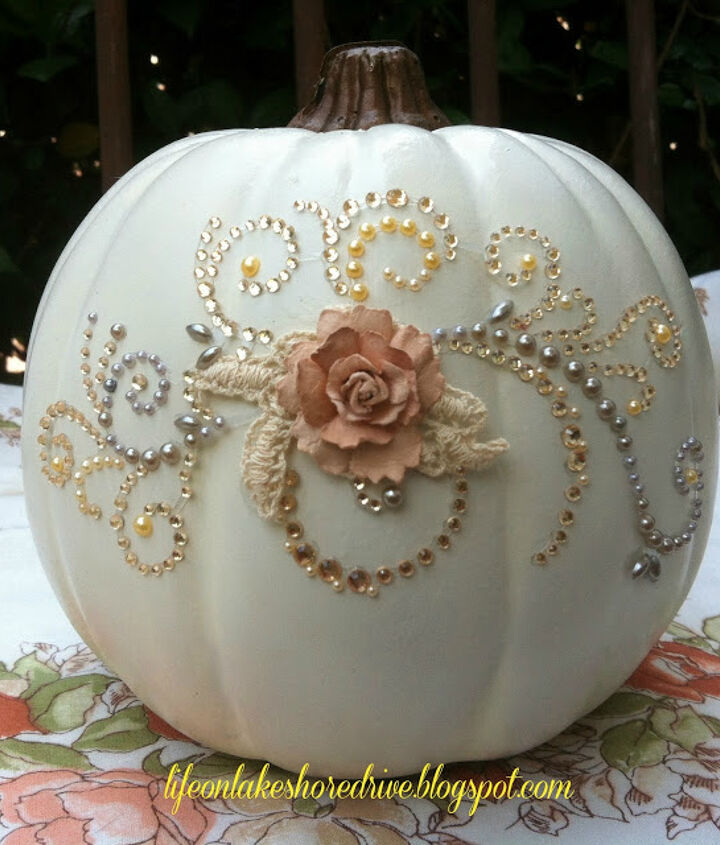 The first step to create this bejeweled pumpkin was to spray it with a semi-gloss off-white spray paint.  I allowed it to dry overnight.