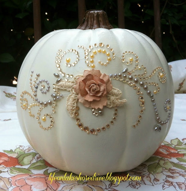 easy glitter and glitz pumpkin, crafts, seasonal holiday decor, The first step to create this bejeweled pumpkin was to spray it with a semi gloss off white spray paint I allowed it to dry overnight