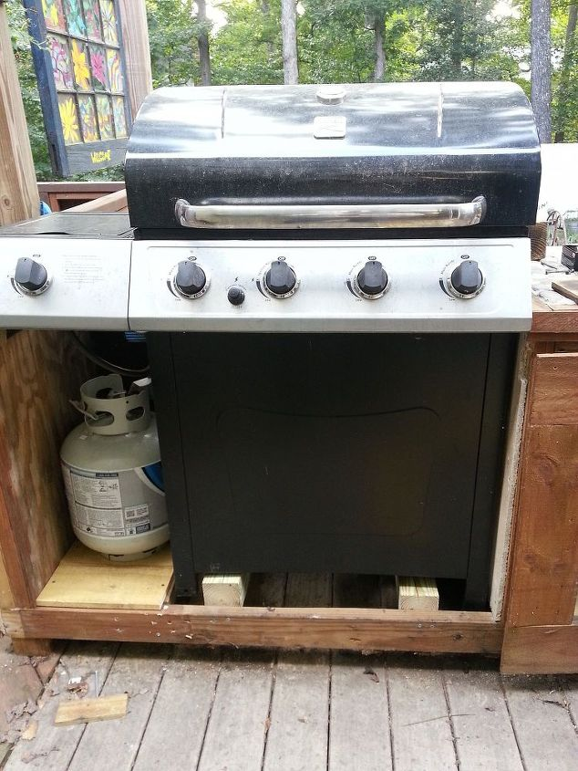 See the grill sets on the 4x4 blocks and the LP tank off to side (reinforced under the wood for the LP). You could actually have the grill sit on the deck