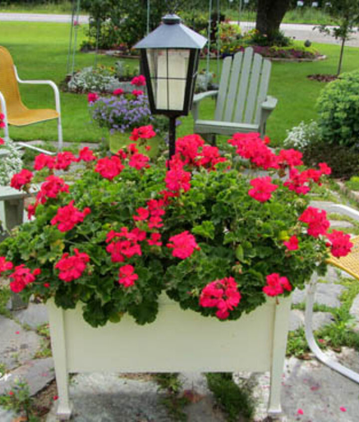 It starts with a flower-ful seating area http://organizedclutterqueen.blogspot.com/2013/08/yard-of-flowers-garden-tour-2013.html
