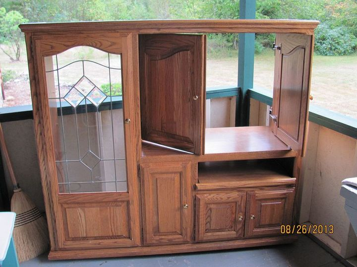 Gorgeous solid oak and oak plywood entertainment center.  These centers are becoming obsolete, but they're too beautiful to waste!