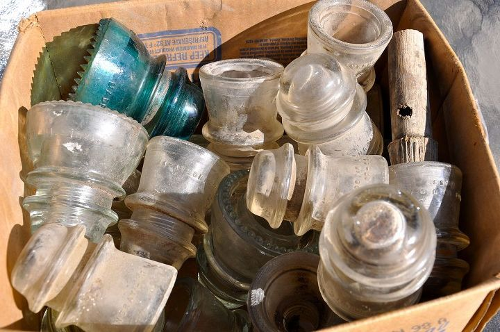 diy reuse glass insulators for succulent planting, flowers, gardening, repurposing upcycling, succulents, Here is a box of insulators I bought at an Antique Store Really dirty