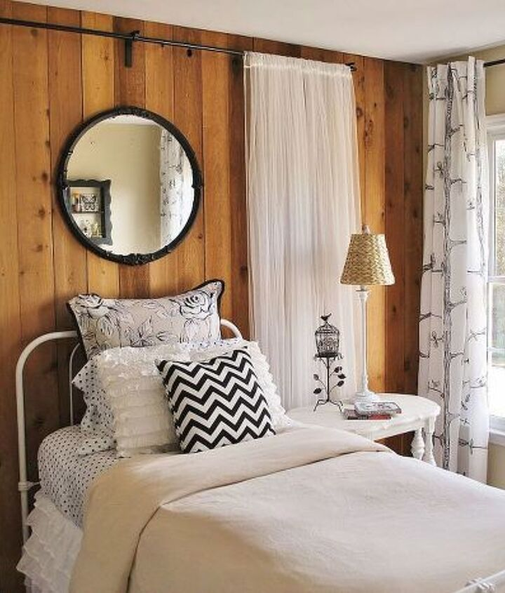 Working around existing wood-paneled wall, I softened the look for a young girl with inexpensive sheer panels