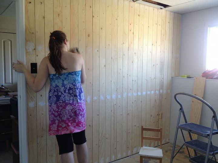 Erika helping out with filling all the screw holes from putting up the plywood planks.