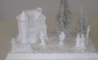 easy dollar store winter village, crafts, seasonal holiday decor, I sprayed the painted village pieces with clear acrylic matt spray for adhesion then dusted everything with snow After they dried I hot glued them to the board I then mod podged the board and added vintage snow