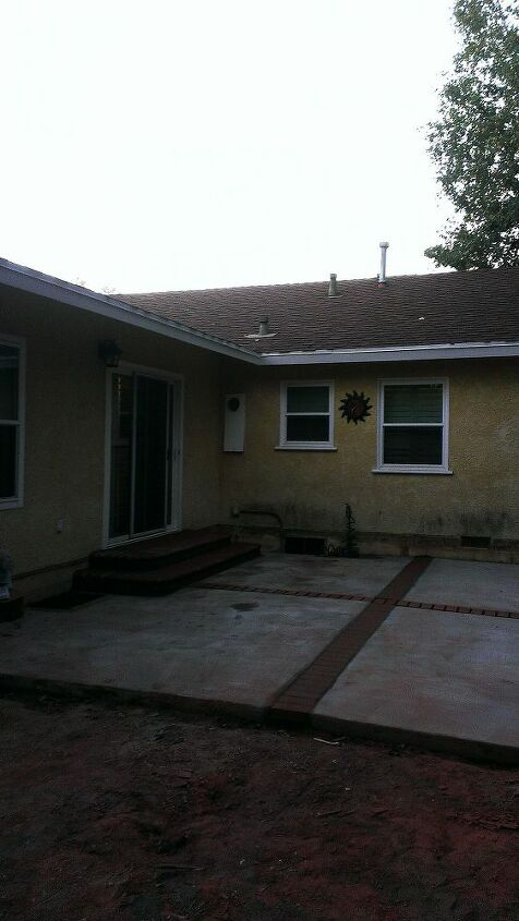 how about a mosaic to cover up newly exposed outside stucco, curb appeal, decks, patio, The stains used to be covered by the deck